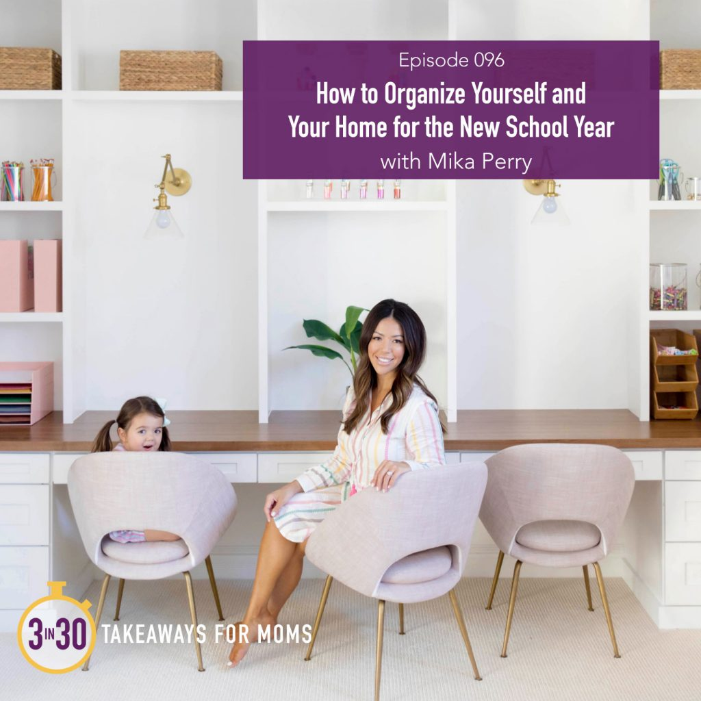096: How to Organize Yourself and Your Home For the New School Year with Mika Perry by popular podcast, 3 in 30: image of Mika Perry sitting at a home office desk with her small daughter.